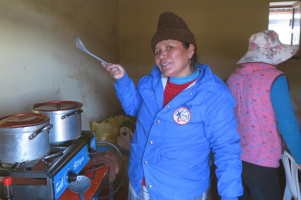 Virginia prepares one of her famous meals for the returing field crew at the Ccoypani field site.