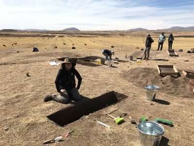 test units are placed around the site in areas of high artifact concentration. Izzy excavating.